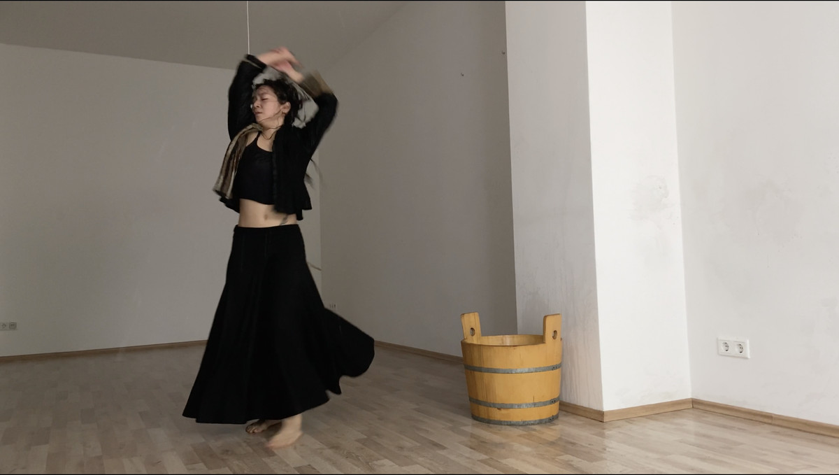 A woman dances in an empty room.