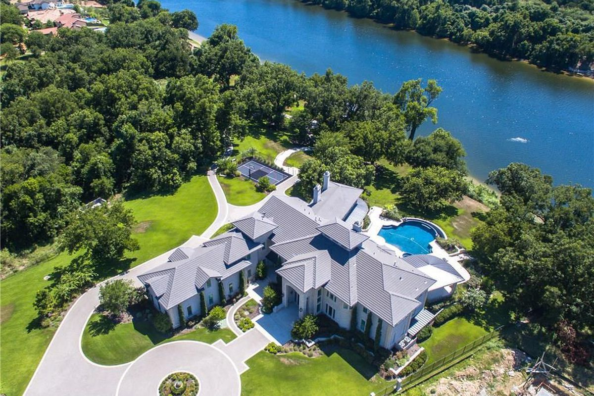 Overhead shot of McMansion on river