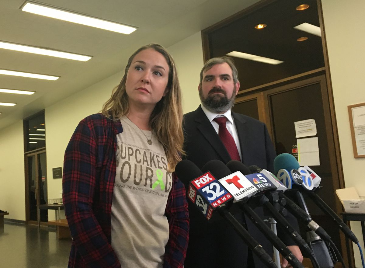 Laura Pekarik, owner of the Cupcakes for Courage food truck, and her attorney, Robert Frommer, spoke to reporters outside a Daley Center courtroom Monday. | Mitch Dudek/Sun-Times