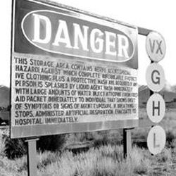 A sign warns of the hazards contained at the Tooele Chemical Depot.