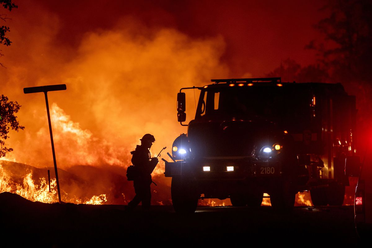A firefighter lights backfires during the Carr fire in Redding, California.