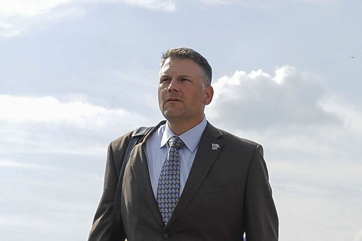 Coach Fuente heading for work.