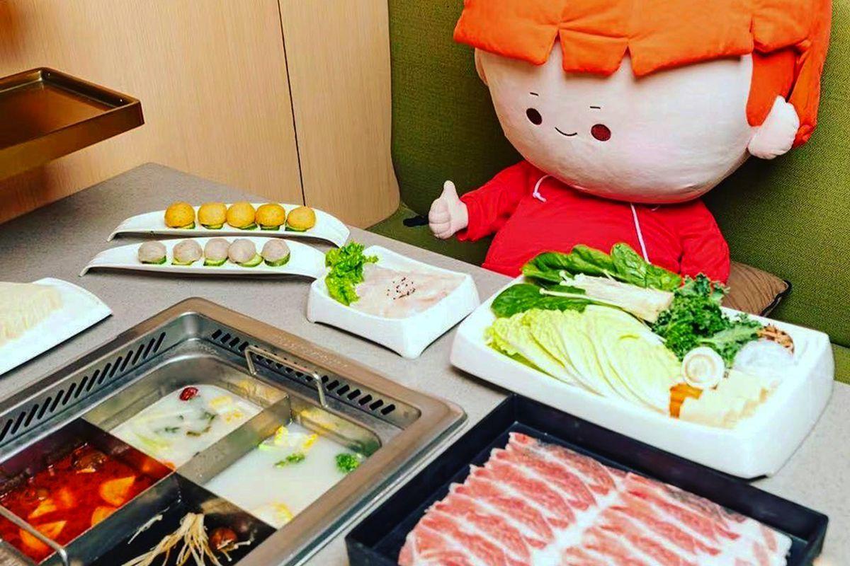 House mascot, Mr. Tomato, at the HaiDiLao Chinese hot pot restaurant.