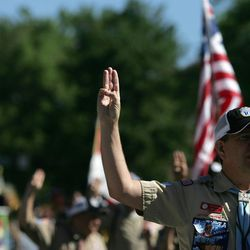Eric Winsor recites the Scouts pledge with the Boy Scouts during the Days of '47 Parade in Salt Lake City on Saturday, July 24, 2010.