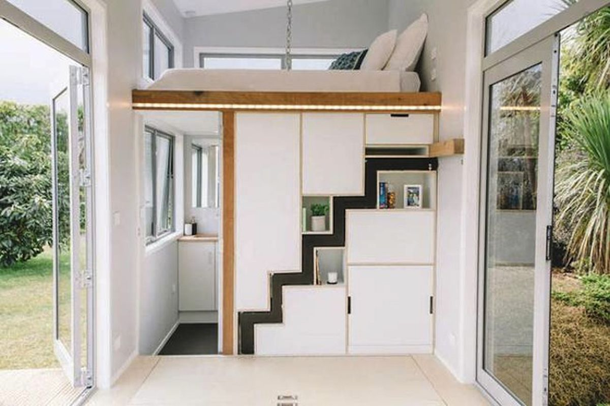 Tiny house for millennials has a retractable staircase - Curbed on tiny house dining tables, tiny house beds, tiny house desks,