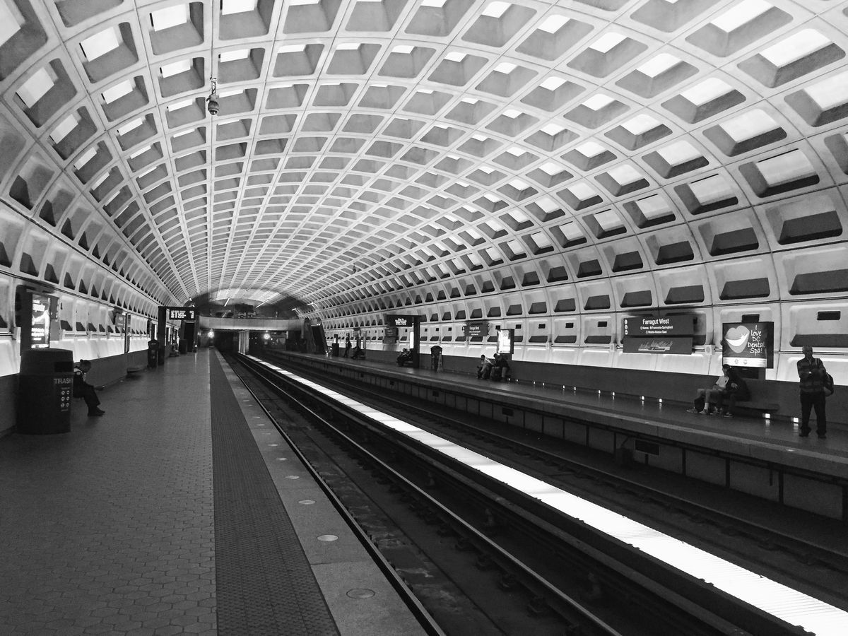 The Dupont Circle station in Washington D.C. The ceiling is vaulted and concrete.