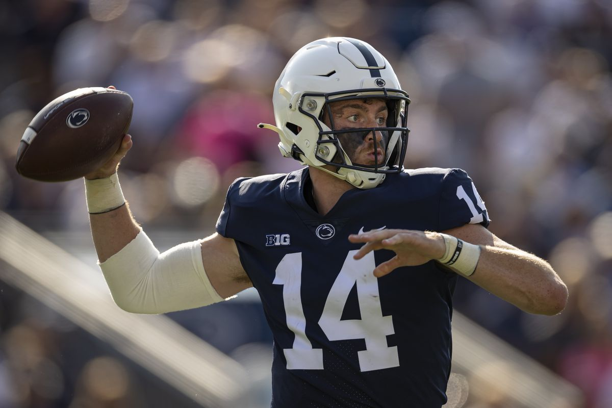 Sean Clifford #14 of the Penn State Nittany Lions attempts a pass against the Ball State Cardinals during the first half at Beaver Stadium on September 11, 2021 in State College, Pennsylvania.