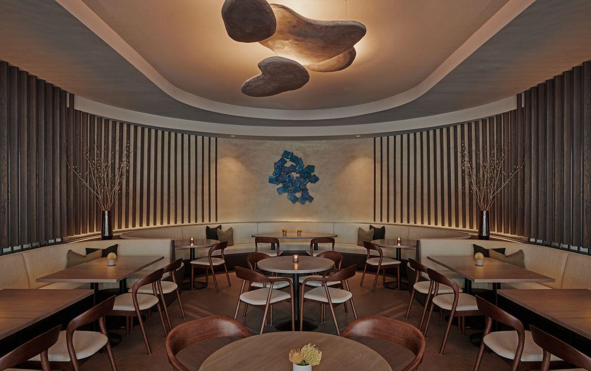 An earth-toned u-shaped dining room
