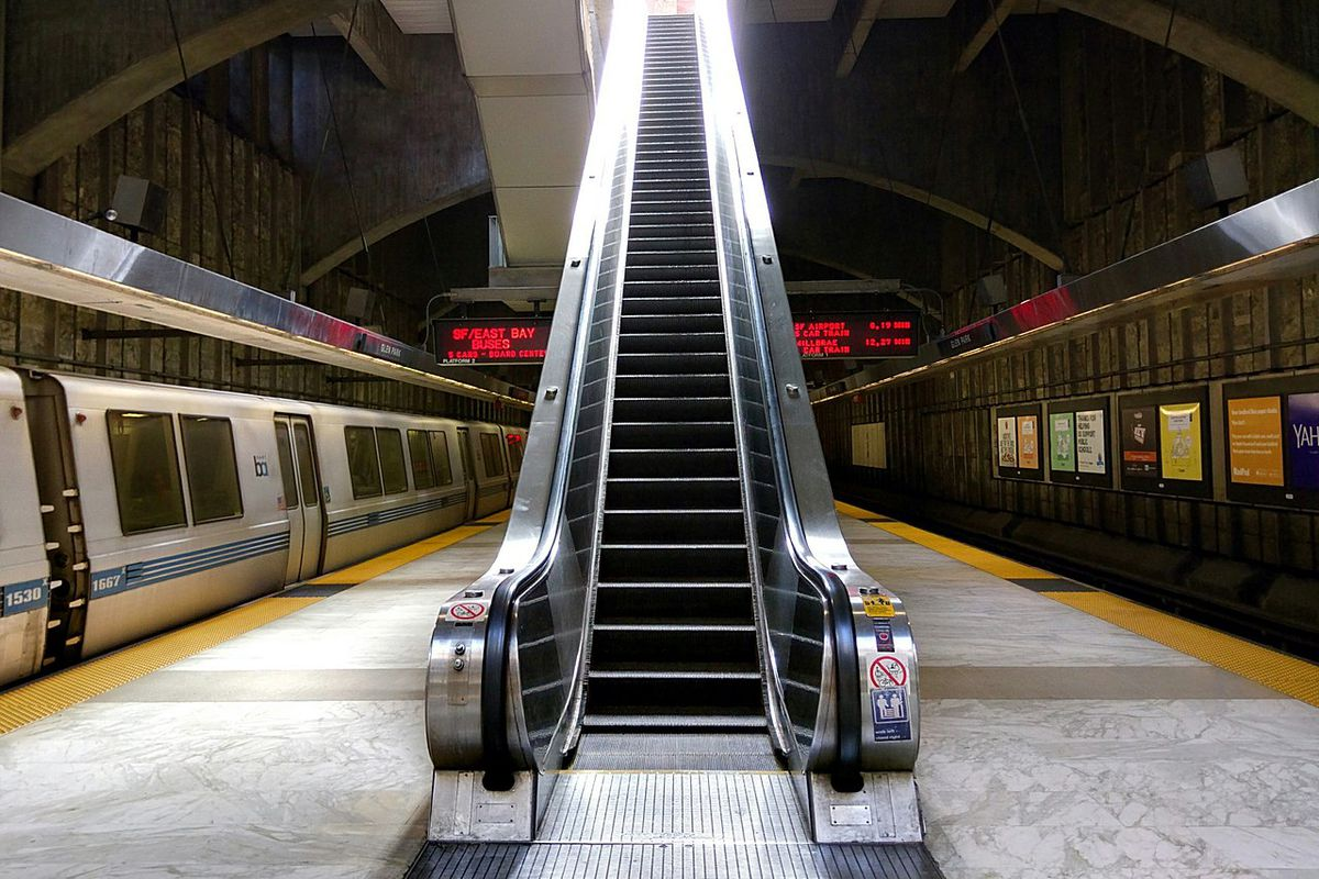 An escalator at Glen Park BART Station.