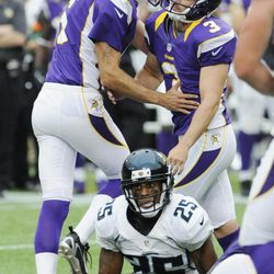 Jacksonville Jaguars strong safety Dwight Lowery (25) sits on the field as Minnesota Vikings punter Chris Kluwe (5), left, congratulates kicker Blair Walsh (3) on his go-ahead field goal during overtime in an NFL football game on Sunday, Sept. 9, 2012, in Minneapolis. The Vikings won 26-23.