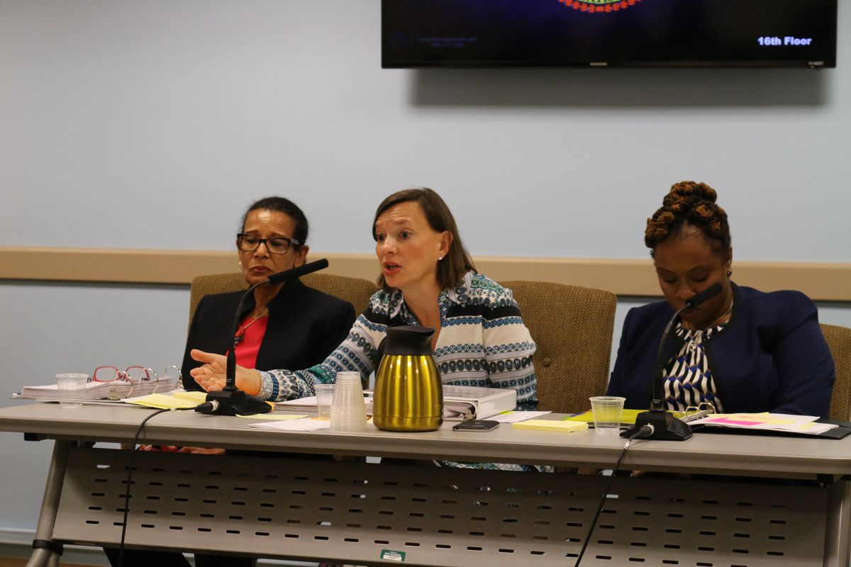 Deputy Chancellor Elizabeth Rose (center) answers questions from lawmakers at a hearing on Wednesday.