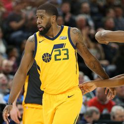 Utah Jazz forward Royce O'Neale (23) and guard Donovan Mitchell (45) celebrate after scoring against the Denver Nuggets at Vivint Smart Home Arena in Salt Lake City on Tuesday, Nov. 28, 2017.