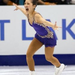 Michelle Kwan, of the U.S., is all smiles after hitting her jumps during her short program on Tuesday, Feb. 19, 2002 at the Salt Lake Ice Center.
