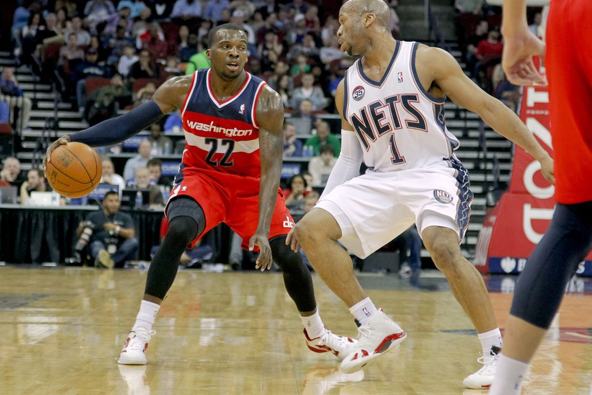 Mar 21, 2012; Newark, NJ, USA;  Washington Wizards guard Shelvin Mack (22) brings the ball up the court as New Jersey Nets guard Sundiata Gaines (1) defends during the first half at the Prudential Center. Mandatory Credit: Jim O'Connor-US PRESSWIRE