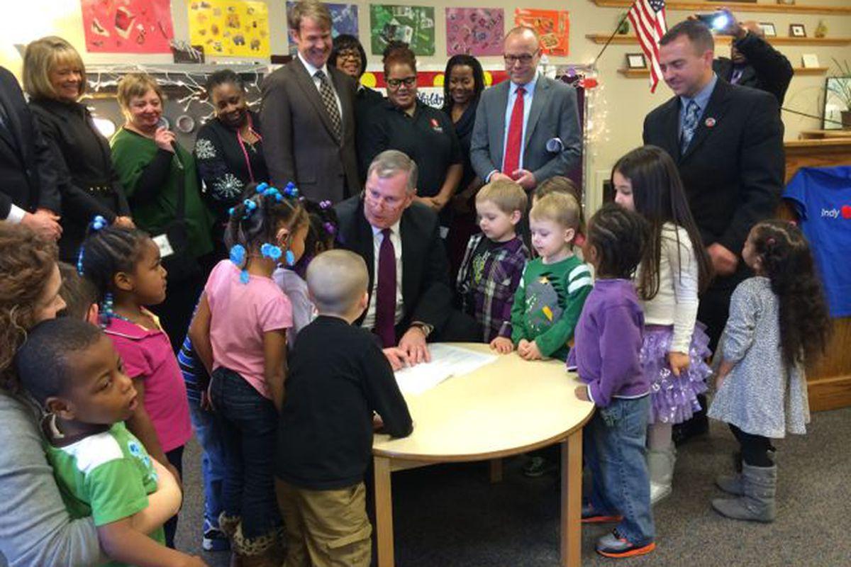 Mayor Greg Ballard signs the city's preschool ordinance at Warren Township Schools.