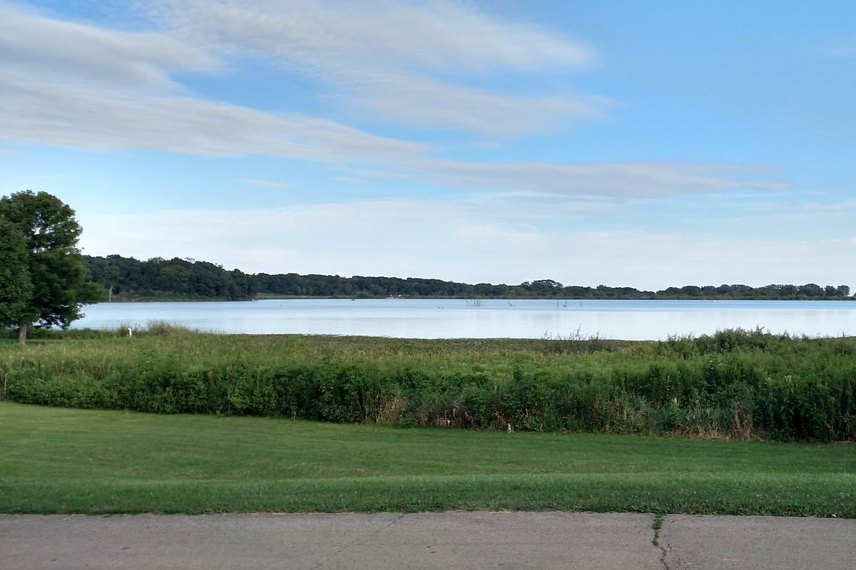 A file photo of evening settling over Shabbona Lake, where Lakeside bait shop will reopen May 29. Credit: Dale Bowman