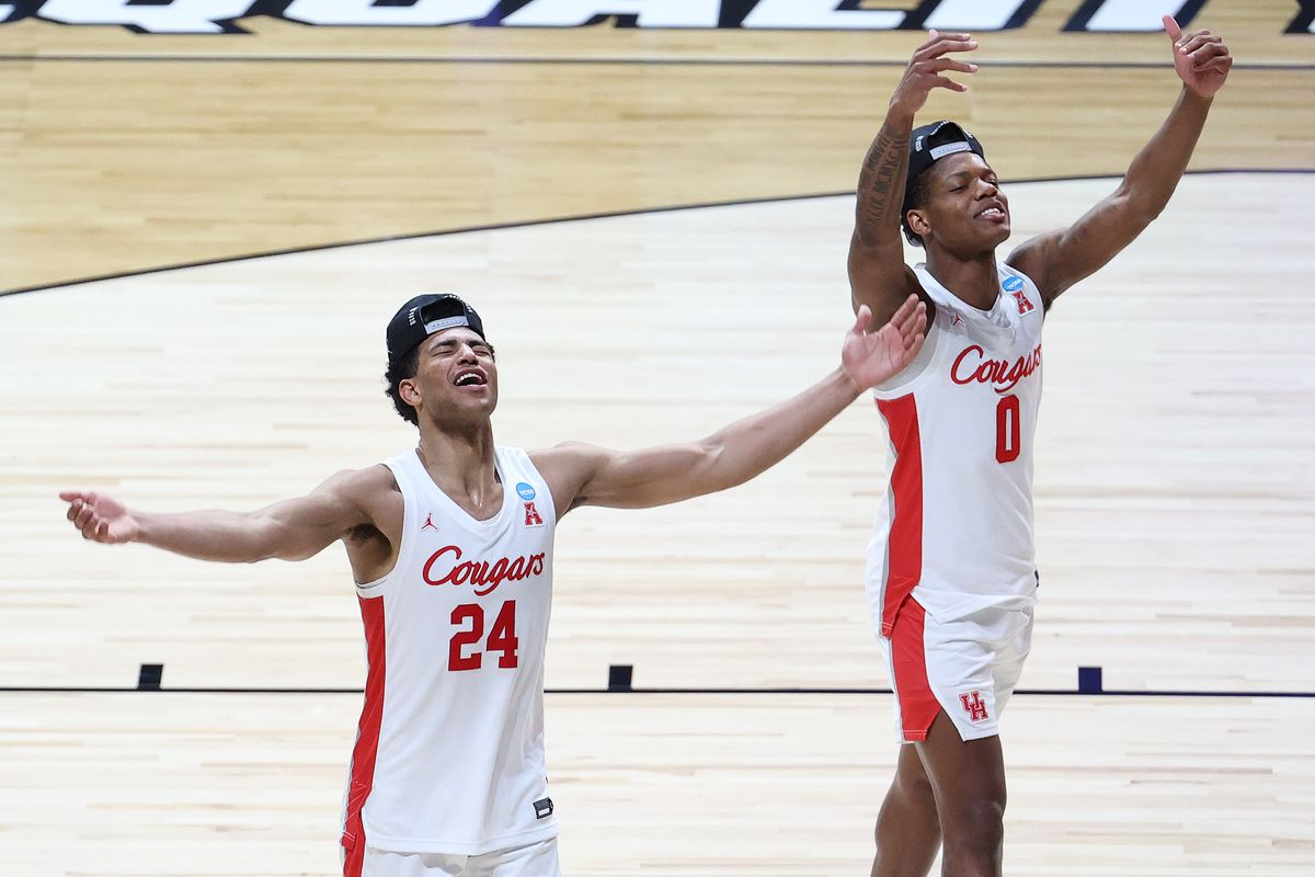 Quentin Grimes of the Houston Cougars and Marcus Sasser celebrate after defeating the Oregon State Beavers in the Elite Eight round of the 2021 NCAA Men's Basketball Tournament at Lucas Oil Stadium on March 29, 2021 in Indianapolis, Indiana.
