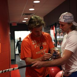 Exchanging sigs and twigs with All-Star teammate Claude Giroux in 2012