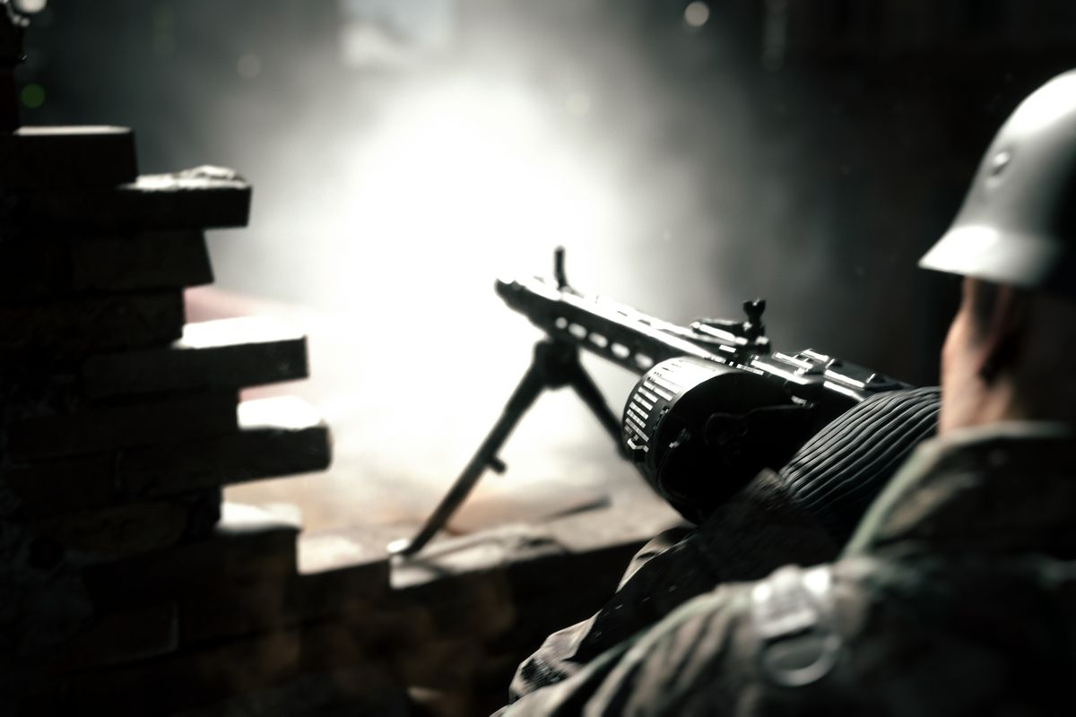 German soldier firing a bipod-mounted machine gun with drum magazine in Hell Let Loose