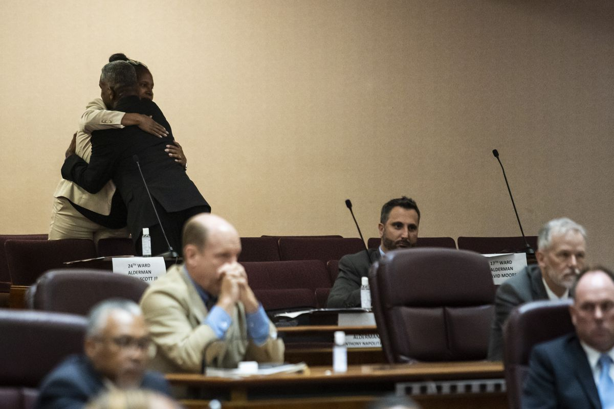Aldermen David Moore (17th) and Sophia King (4th) hug after the Chicago City Council passed the ordinance they co-sponsored, changing the name of Lake Shore Drive to Jean Baptiste Point DuSable Lake Shore Drive during a meeting at City Hall, Friday afternoon, June 25, 2021.