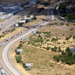 Southbound traffic is backed up after a fatal plane crash shut down northbound I-15 and closed lanes in southbound I-15 in Riverdale on Wednesday, July 26, 2017. All four people on board died.