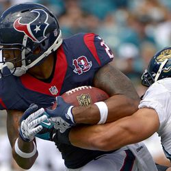 Houston Texans running back Arian Foster, left, is tackled after a short gain by Jacksonville Jaguars outside linebacker Russell Allen during the first half of an NFL football game, Sunday, Sept. 16, 2012, in Jacksonville, Fla.