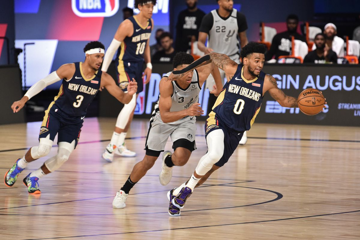 Nickeil Alexander-Walker of the New Orleans Pelicans dribbles the ball up court against the San Antonio Spurs on August 9, 2020 in Orlando, Florida at The Field House.