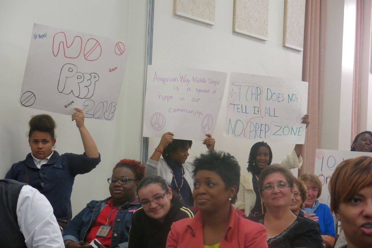 American Way Middle School students protested during Tuesday night's Shelby County School Board business meeting. More than 20 people signed up for public comment with the majority opting to speak against the Achievement School District's takeover process.