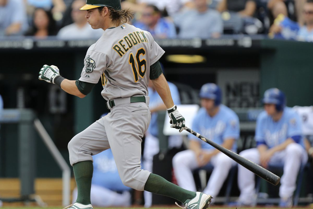 KANSAS CITY, MO - JUNE 3:  Josh Reddick #16 of the Oakland Athletics hits a single in the eighth inning against the Kansas City Royals at Kauffman Stadium June 3, 2012 in Kansas City, Missouri. The Royals won 2-0. (Photo by Ed Zurga/Getty Images)