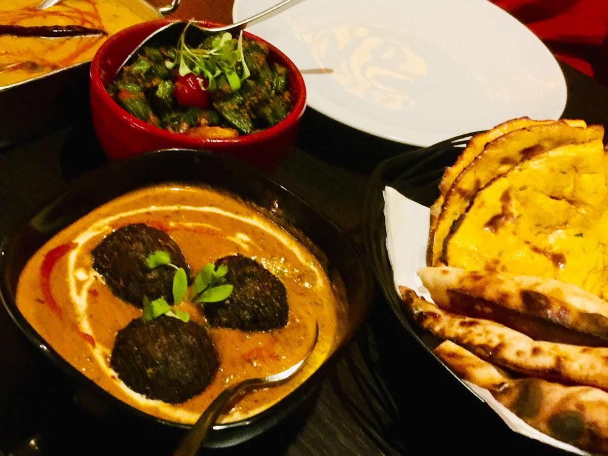 Naan, salad, and curry at Grand Trunk Road, one of the best north Indian restaurants in London