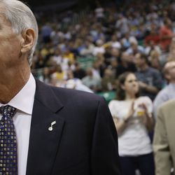 Utah Jazz head coach Jerry Sloan dons a pin on his lapel in memory of Larry H. Miller as the Utah Jazz host the Los Angeles Lakers in Game 3 at the Energy Solutions Arena in Salt Lake City on Thursday, April 23, 2009.