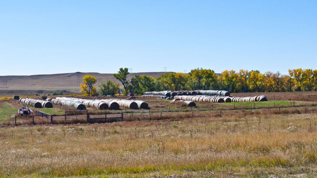 Nebraska, Crawford, Rolled and Stacked Bales of Hay