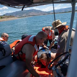 Weber Fire District and Weber County Sheriff's Department personnel pull a mock victim out of the water while practicing water rescue skills at Pineview Reservoir near Huntsville, Weber County, on Monday, June 28, 2021.