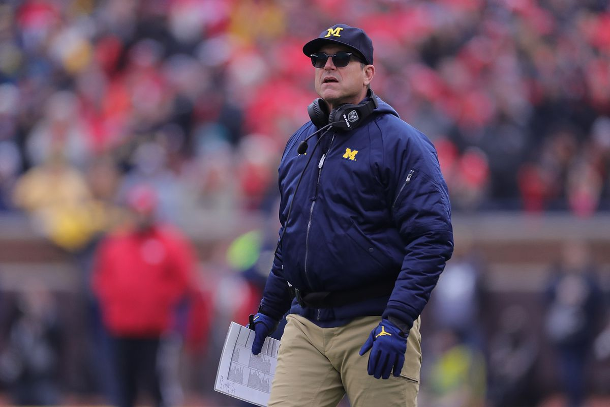 Michigan Wolverines Head Football Coach Jim Harbaugh reacts to a call during the second quarter of the game against the Ohio State Buckeyes at Michigan Stadium on November 30, 2019 in Ann Arbor, Michigan. Ohio State defeated Michigan 56-27.
