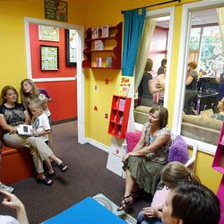 Utah authors sit in the children's room at Fire Petal Books in Centerville during the store's Author Night.