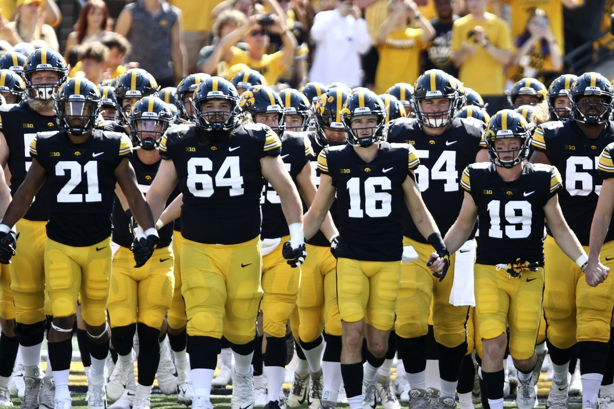 Members of the Iowa Hawkeyes take the field before the match-up against the Kent State Golden Flashes at Kinnick Stadium on September 18, 2021 in Iowa City, Iowa.