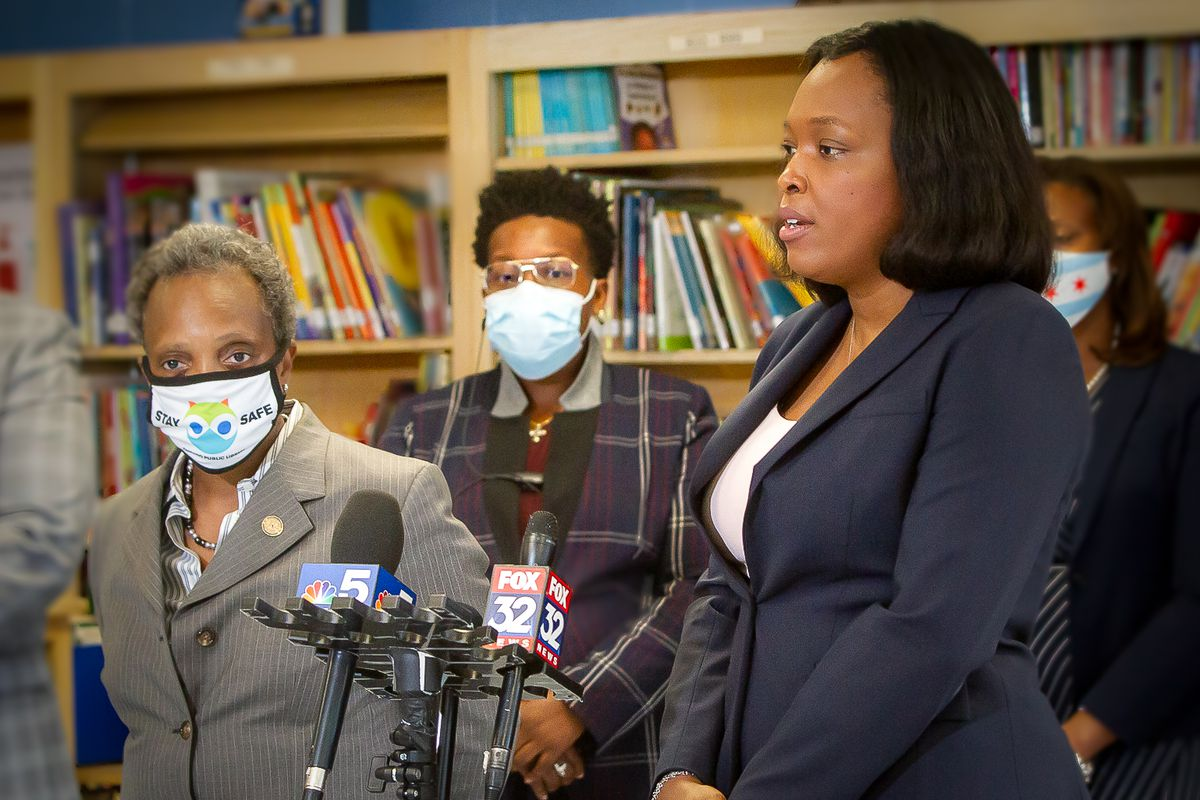 Mayor Lori Lightfoot and school chief Janice Jackson standing by a microphone.