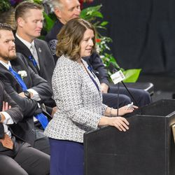 Erika Barney speaks during funeral services for her husband, Unified police officer Doug Barney, at the Maverik Center in West Valley City Monday, Jan. 25, 2016.