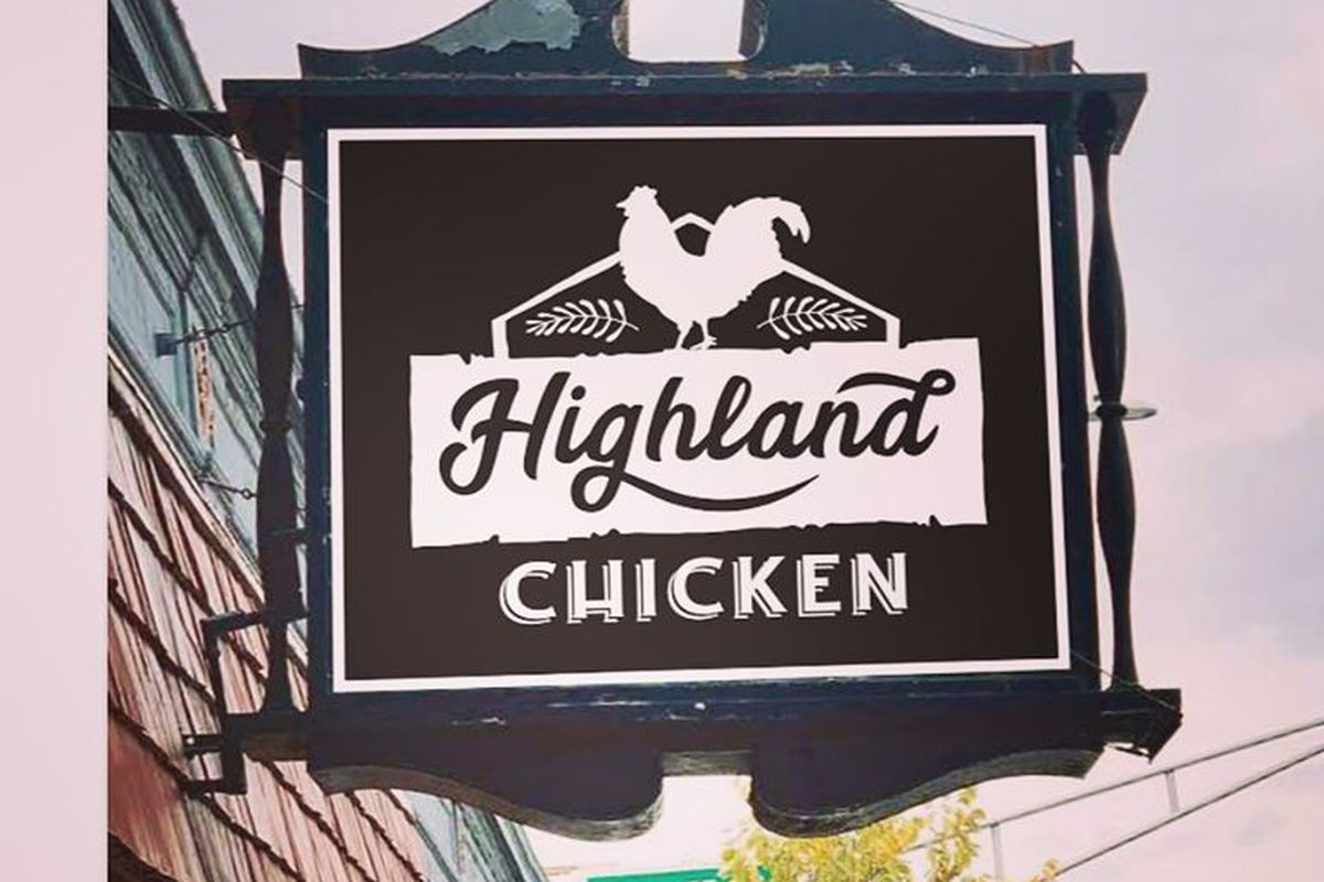 """White text on black signage outside a restaurant reads """"highland chicken,"""" with a chicken logo in white"""