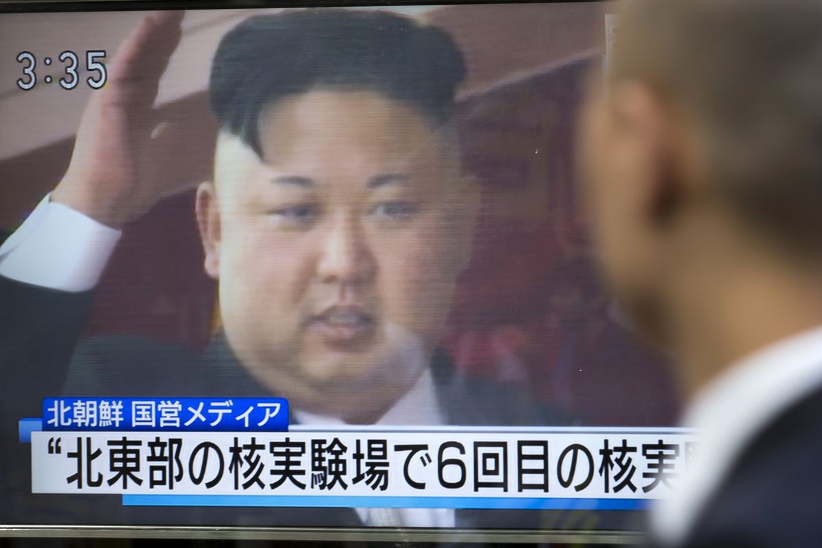 A pedestrian watches a monitor showing an image of North Korean leader Kim Jong Un in a news program on September 3, 2017 in Tokyo, Japan.