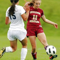 Maple Mountain's #11 Sophie Card, right, kicks the ball past Timpanogos' #15 Marcy Fuller during play Tuesday, Sept. 25, 2012. Maple Mountain won 2-1.
