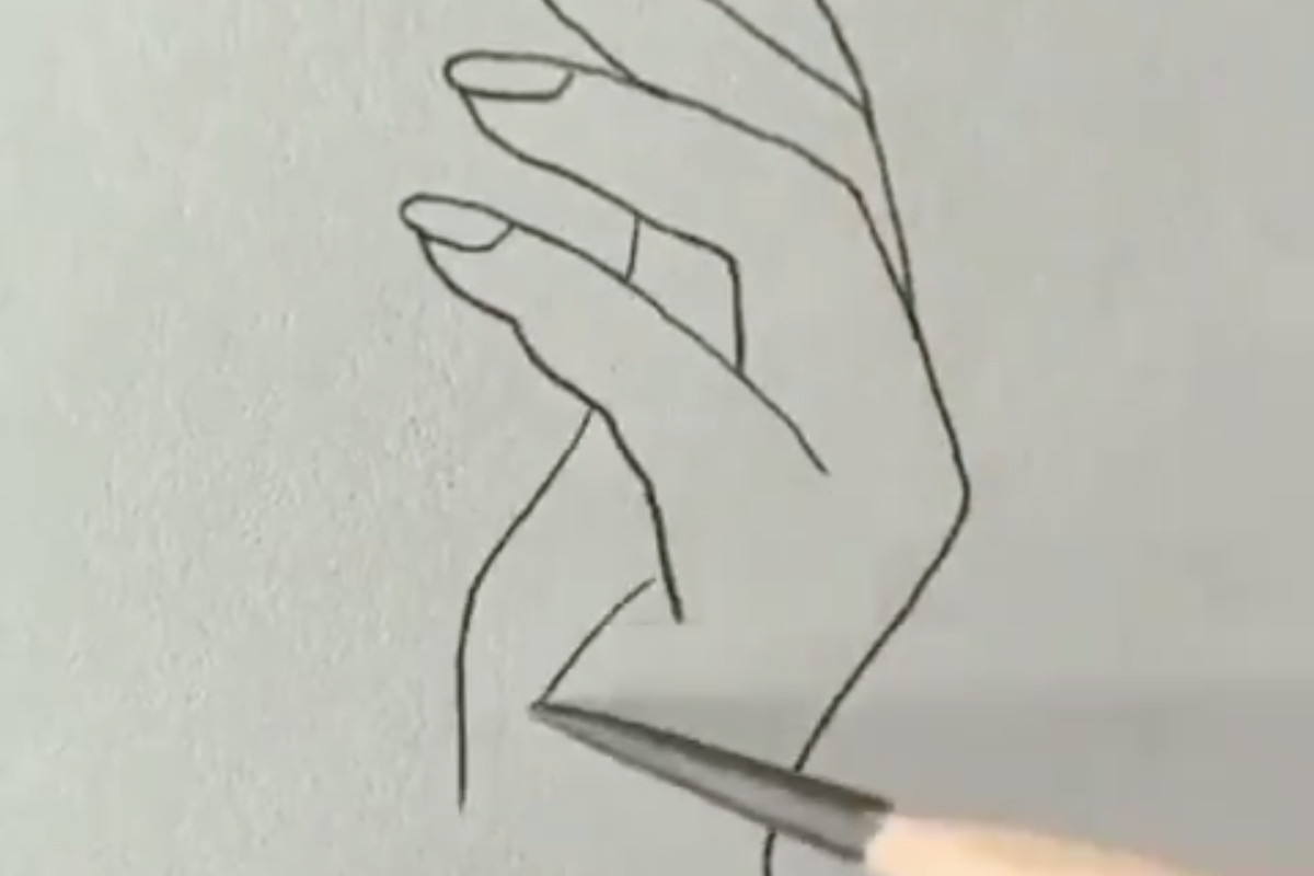 A person drawing a hand