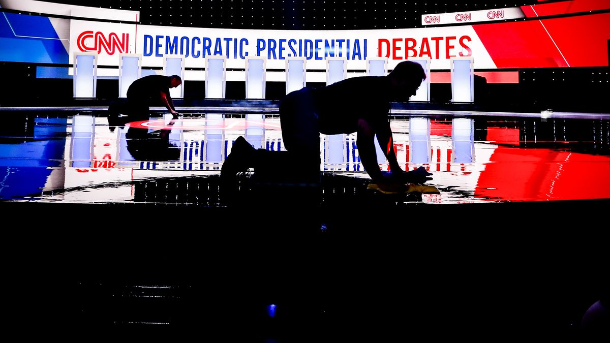 Workers get the stage ready for the Democratic primary debate held at the Fox Theatre in Detroit, Michigan, on July 30, 2019.