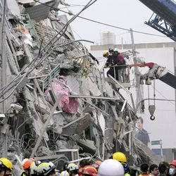In this photo released by China's Xinhua News Agency, rescuers search for survivors at a quake site in Tainan, Taiwan Saturday, Feb. 6, 2016. A powerful, shallow earthquake struck southern Taiwan before dawn Saturday.