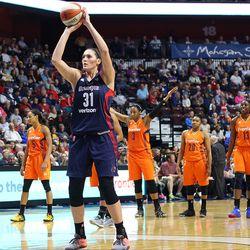 Washington Mystics' Stefanie Dolson (31) tries to shoot a free throw as Kelsey Bone (3) encourages the crowd to get louder.