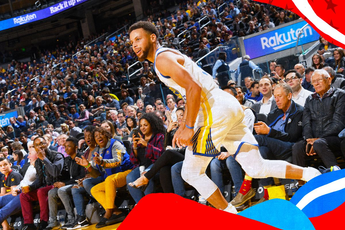 Stephen Curry runs back after making a basket.