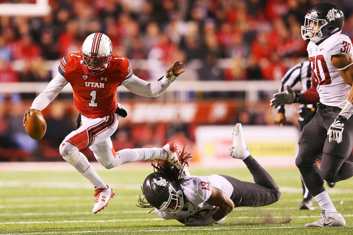 Utah Utes quarterback Tyler Huntley (1) is brought down by Washington State Cougars linebacker Jahad Woods (13) as Utah and Washington State play a College football game at Rice Eccles Stadium at the University of Utah in Salt Lake City on Saturday, Nov.
