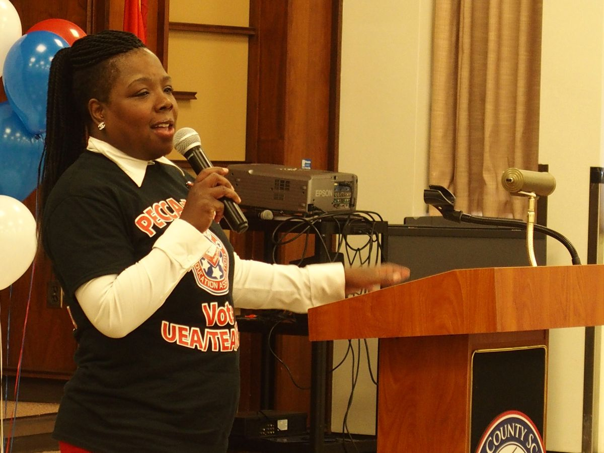 Tikeila Rucker addresses teachers during a rally to start negotiations between the district and teacher groups.
