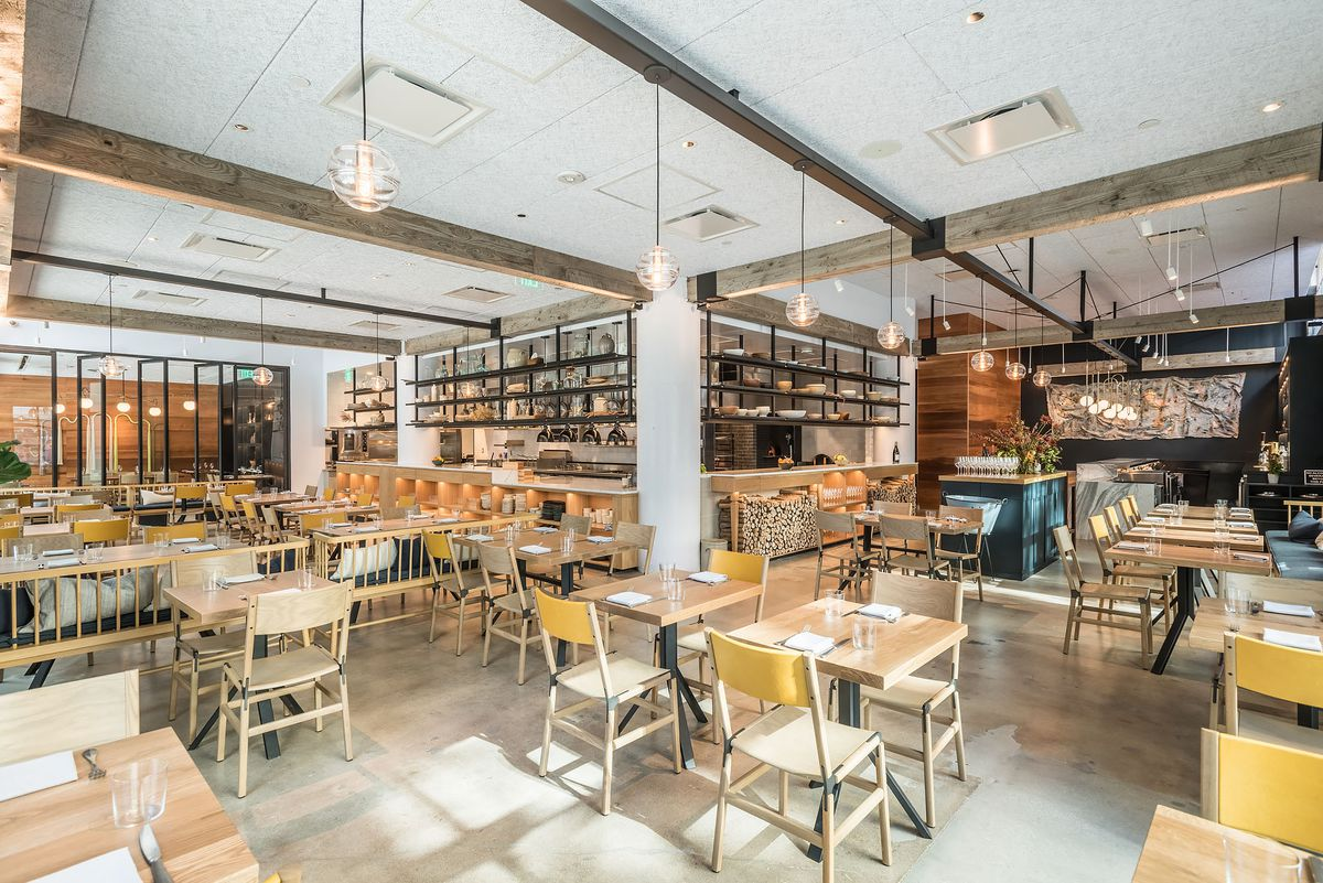 A sunny open warehouse restaurant space.