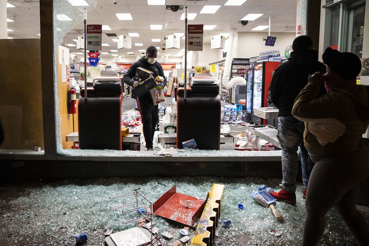 Protesters loot a CVS store on Kinzie near LaSalle in River North as thousands in Chicago joined national outrage over the killing of George Floyd in Minneapolis police custody, Saturday afternoon, May 30, 2020.